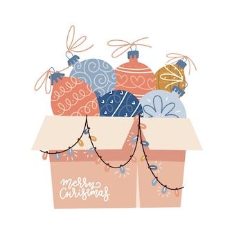 Caixa de papelão transbordando de decorações de natal com enfeites de árvore de natal bolas de enfeites ...