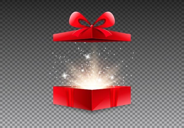 Caixa de presente aberta com laço e fita vermelhos.