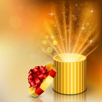 Caixa de presente aberto com brilhantes raios de luz