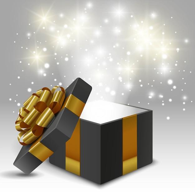 Caixa de presente aberto com laço de ouro e luzes