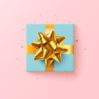 Caixa de presente azul com fita dourada