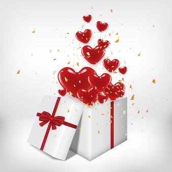Caixa de presente branca aberta e balão de coração vermelho flutuando.