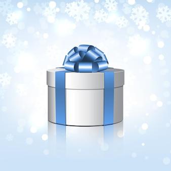 Caixa de presente branca com um laço azul. ilustração em fundo de flocos de neve
