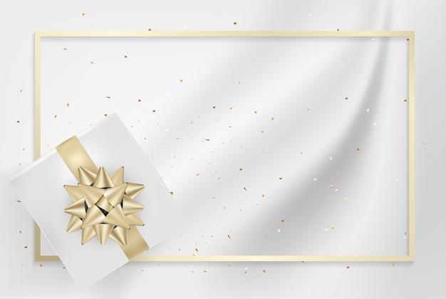 Caixa de presente branca e fitas de laço de ouro com textura de seda luz confete.