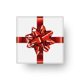 Caixa de presente branca realista com um laço vermelho brilhante