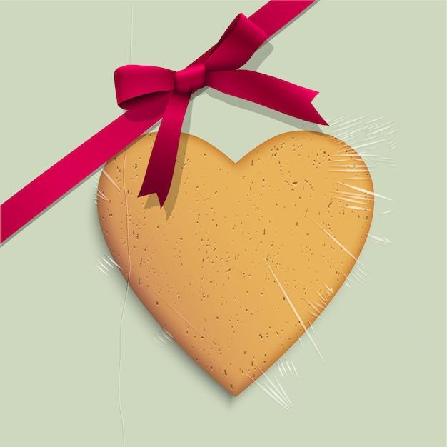Caixa de presente com biscoito de coração em forma de fita rosa amarrada