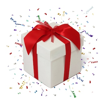 Caixa de presente com fita vermelha e arco em fundo branco com confete e fitas coloridas.