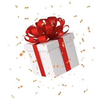 Caixa de presente com um laço vermelho, confete dourado caindo