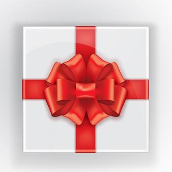 Caixa de presente com um vôo de laço vermelho. vista superior de um presente.