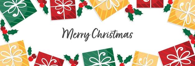 Caixa de presente de natal e ramo de bagas de azevinho decoram em fundo branco para moldura de banner ou cabeçalho