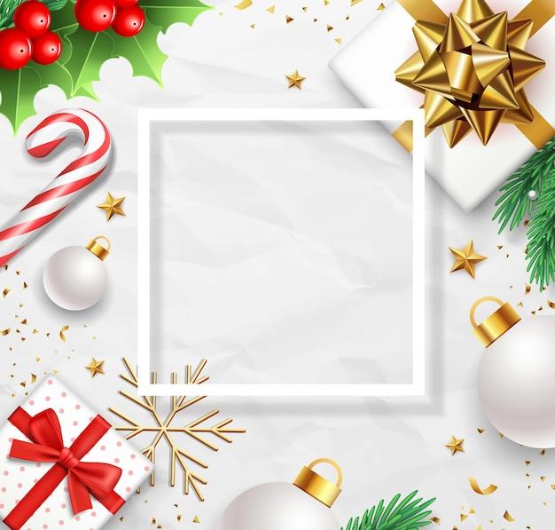 Caixa de presente de natal feliz com fita dourada, folhas de pinheiro, bastão de doces, azevinho