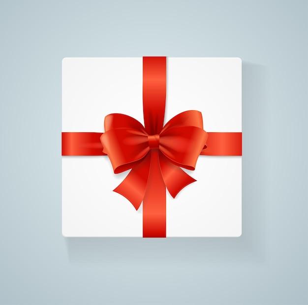 Caixa de presente e laço vermelho. ilustração vetorial