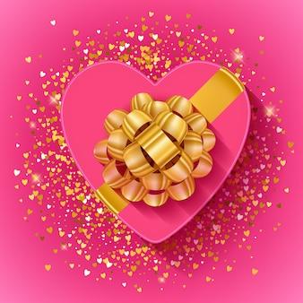 Caixa de presente em forma de coração de são valentim com fita de ouro.