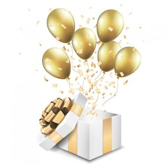 Caixa de presente ouro aberto com balões