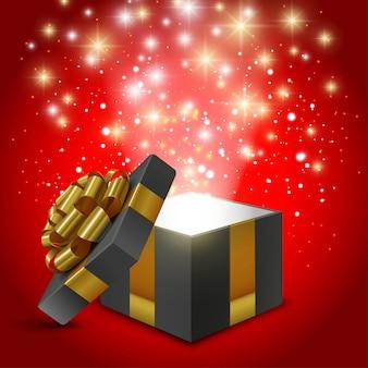 Caixa de presente preta aberta com laço dourado e luzes brilhantes