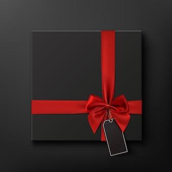 Caixa de presente preta em branco com fita vermelha e etiqueta de preço. informações básicas conceituais de venda de sexta-feira negra. ilustração.