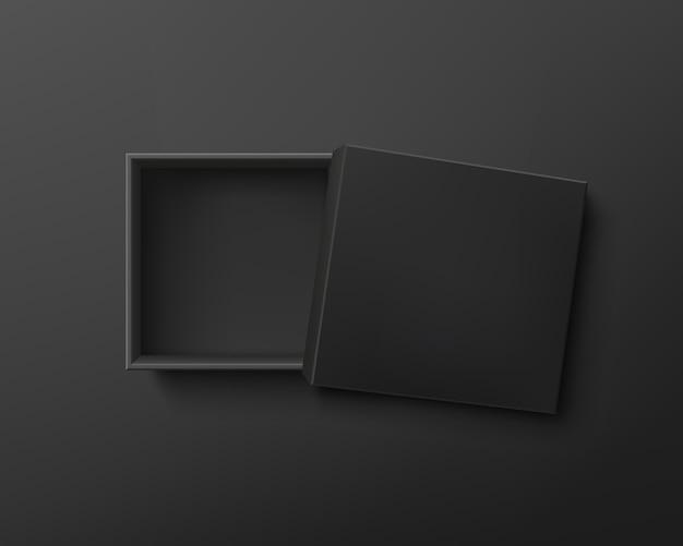 Caixa de presente preta vazia aberta em fundo escuro