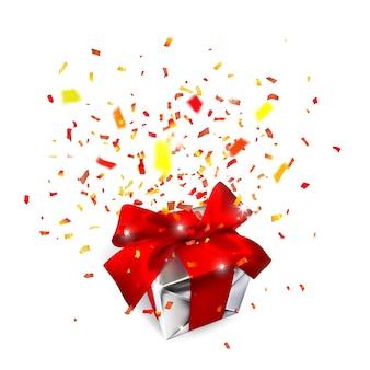 Caixa de presente realista com laço vermelho e confete isolado no branco