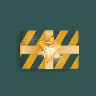 Caixa de presente realista com listras verdes e amarelas, fitas douradas e laço. ilustração vetorial. tendências de cores.