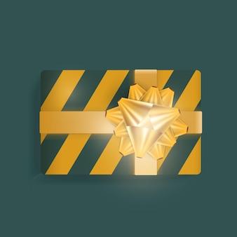 Caixa de presente realista com listras verdes e amarelas, fitas douradas e laço. vetor