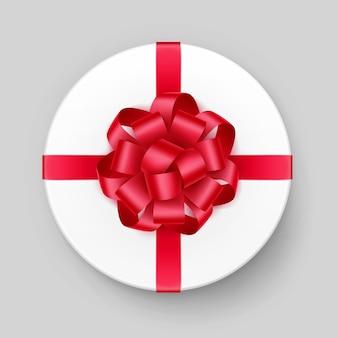 Caixa de presente redonda branca com brilhante laço vermelho escarlate e vista superior da faixa de opções no plano de fundo