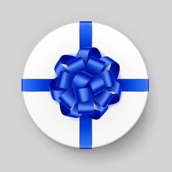 Caixa de presente redonda branca com laço azul brilhante e vista superior da fita, close-up no fundo