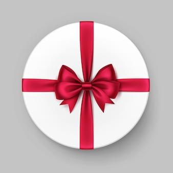 Caixa de presente redonda branca com laço e fita de cetim vermelho brilhante