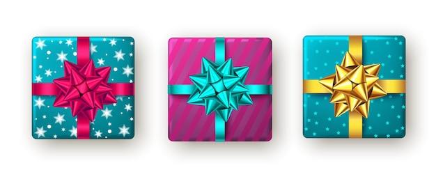 Caixa de presente rosa dourado azul com fita e arco vista de cima design de pacote de festa de ano novo de natal