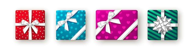 Caixa de presente vermelha azul rosa e verde com fita e arco vista de cima design de embalagem de natal