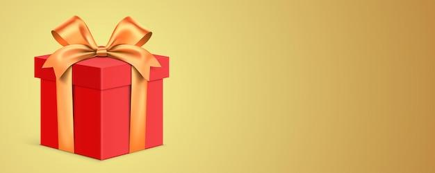 Caixa de presente vermelha embrulhada com fita dourada