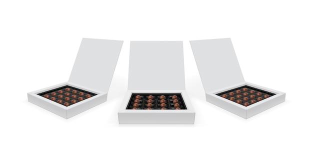 Caixa quadrada com chocolates isolados no branco Vetor Premium
