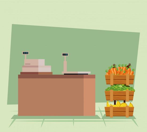 Caixa registradora com cenoura e brócolis legumes com bananas