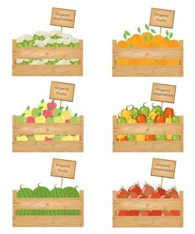 Caixas de madeira com legumes e frutas.