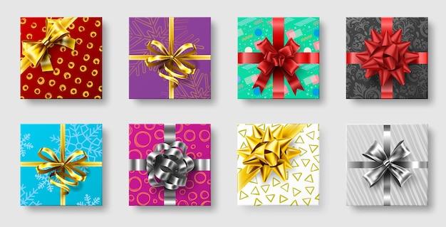 Caixas de presente com laço de fita. arcos de decoração de presentes, vista superior de férias de natal apresenta caixas.
