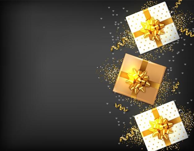 Caixas de presente com laço dourado