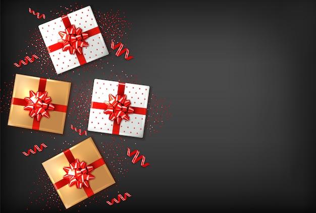 Caixas de presente com laço vermelho