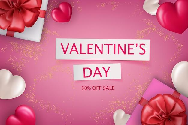 Caixas de presente com laços vermelhos e corações em um fundo com decoração de ouro para a venda do dia dos namorados.