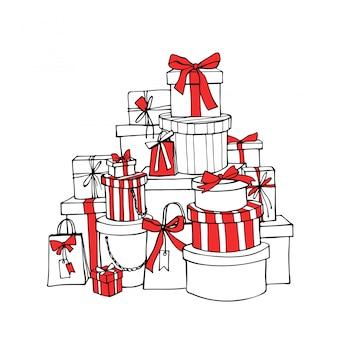 Caixas de presente de natal com fitas vermelhas e laços.