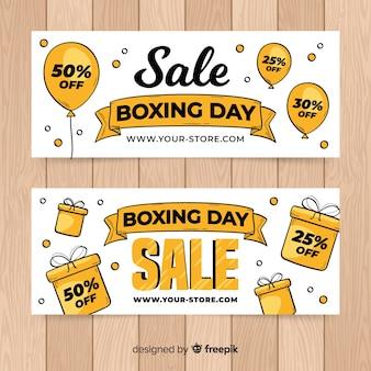 Caixas e balões boxe dia venda banner