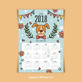 Calendário 2018 com um cachorrinho e flores desenhadas à mão