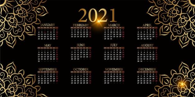 Calendário 2021 com ornamento de mandala ou desenho de fundo de flor.