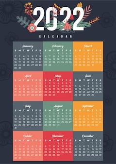 Calendário 2022 moderno e colorido com formas e flores multicoloridas