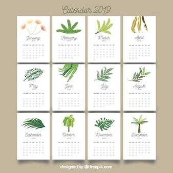 Calendário agradável de 2019 com folhas coloridas Vetor grátis