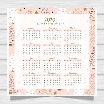 Calendário ano novo com fundo de madeira.