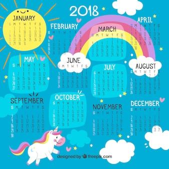 Calendário colorido de 2018 com unicórnio e arco-íris