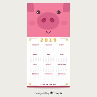 Calendário de ano novo chinês de rosto de porco