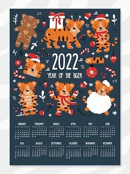 Calendário de ano novo e natal para 2022 com tigres engraçados em estilo cartoon
