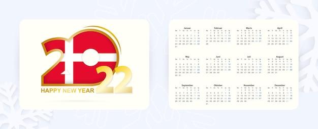 Calendário de bolso horizontal 2022 no idioma dinamarquês. ícone de ano novo 2022 com bandeira da dinamarca.