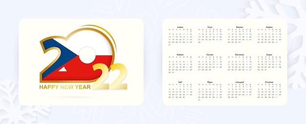 Calendário de bolso horizontal 2022 no idioma tcheco. ícone de ano novo 2022 com bandeira da república tcheca.