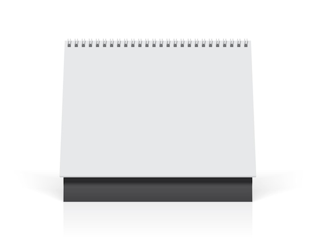 Calendário de papel branco está em cima da mesa Vetor Premium